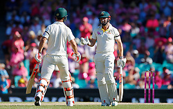 Australia's Shaun Marsh shakes hands with his brother Mitch congratulating him on his fifty during day two of the Ashes Test match at Sydney Cricket Ground.