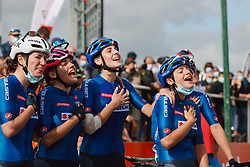 The Italian team sing along to the national anthem at the 2020 UEC Road European Championships - Under 23 Women Road Race, a 81.9 km road race in Plouay, France on August 26, 2020. Photo by Sean Robinson/velofocus.com