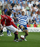 Photo: Chris Ratcliffe.<br />Reading v Manchester United. The Barclays Premiership. 23/09/2006.<br />James Harper of Reading clashes with Gabriel Heinze (L) of Man Utd.