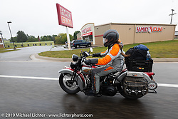 Cris Sommer-Simmons riding through the rain on her 1934 Harley-Davidson VD during the Cross Country Chase motorcycle endurance run from Sault Sainte Marie, MI to Key West, FL. (for vintage bikes from 1930-1948). Stage 1 from Sault Sainte Marie to Ludington, MI USA. Friday, September 6, 2019. Photography ©2019 Michael Lichter.