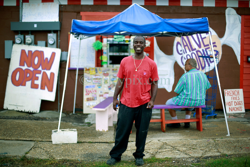 27 August 2014. Lower 9th Ward, New Orleans, Louisiana.<br /> Hurricane Katrina 9 years later. Burnell Cotlon prepares to open the first grocery store set to return to the Lower 9th Ward.  The building is being renovated and will be officially opened on September 9th as the area continues to struggle to recover from Hurricane Katrina.<br /> Photo; Charlie Varley/varleypix.com