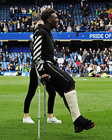 Football - 2018 / 2019 Premier League - Chelsea vs. Watford<br /> <br /> Huson Odoi of Chelsea gets around the pitch with a pair of Crutches after the final home match, at Stamford Bridge.<br /> <br /> COLORSPORT/ANDREW COWIE
