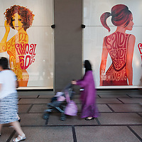 MILAN, ITALY - JULY 03:  Shoppers walk in front of a sale sign in the fashion district of Milan on July 3, 2010 in Milan, Italy. Milan's summer sales start today. .***Agreed Fee's Apply To All Image Use***.Marco Secchi /Xianpix. tel +44 (0) 207 1939846. e-mail ms@msecchi.com .www.marcosecchi.com