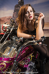 LowRide Magazine's Sara Jukic on a heavily customized Harley-Davidson Sportster at EICMA, the largest international motorcycle exhibition in the world. Milan, Italy. November 21, 2015.  Photography ©2015 Michael Lichter.