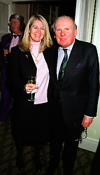 MR & MRS GAY KINDERSLEY he is the former leading amateur jockey and chairman of the amateur jockey association, at a reception in London on 11th January 2000.OAA 15