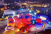 QIANXINAN, CHINA - OCTOBER 11: (CHINA OUT) <br /> <br /> Participants light the fire balloons at Jushan square during The First International Mountain Tourism Conference on October 11, 2015 in Qianxinan Buyei and Miao Autonomous Prefecture, Guizhou Province of China. Fire balloons flied above the Wanfenglin scenic area which was famous for the karst as ten thousand peaks were located in during The First International Mountain Tourism Conference in Guizhou.<br /> ©Exclusivepix Media