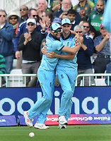 Cricket - 2019 ICC Cricket World Cup - Group Stage: England vs. Pakistan<br /> <br /> Chris Woakes of England celebrates his catch with Mark Wood for his wicket of imam -ul - Haq, at Trent Bridge, Nottingham.<br /> <br /> COLORSPORT/ANDREW COWIE