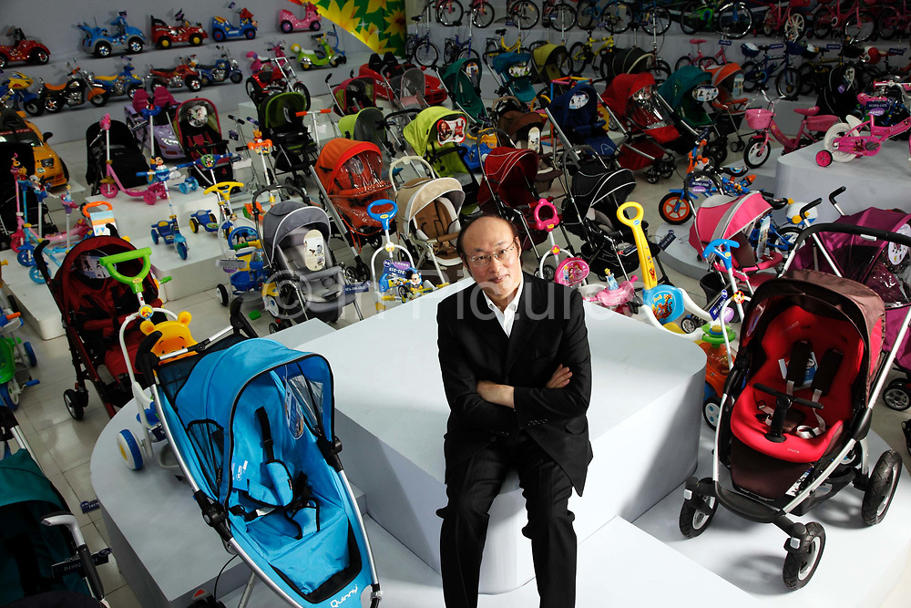 Song Zhenghuan, chief executive officer and chairman of Goodbaby Child Products Company, poses for photographs at the company's showroom in Kunshan, Jiangsu Province, China, on Monday, May 04, 2009. Once a middle school teacher, Mr. Song is now a self-made billionaire industrialist, his company is China's largest manufacturer and supplier of infants' and children's products.