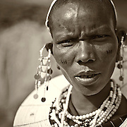 """""""Masai Woman""""                                                 Tanzania<br />  I knew immediately by her piercing gaze, this Masai woman was not only strong in body, but stronger in spirit."""