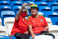 CARDIFF, WALES - Saturday, June 5, 2021: Wales supporters take a selfie before an International Friendly between Wales and Albania at the Cardiff City Stadium in their game before the UEFA Euro 2020 tournament. (Pic by David Rawcliffe/Propaganda)