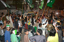 June 18, 2017 - Hyderabad, Sindh, Pakistan - HYDERABAD,PAKISTAN-JUNE 18: Pakistani youngsters holding Pakistani flag and performing dance after the wining of final match between Pakistan and India in champions trophy on June 18 (Credit Image: © Janali Laghari/Pacific Press via ZUMA Wire)