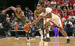 October 23, 2017 - USA - Miami Heat's James Johnson (16) reaches for the ball with Atlanta Hawks' Kent Bazemore (24) in the first quarter at the AmericanAirline Arena Monday, Oct. 23, 2017 in Miami. The Heat won, 104-93. (Credit Image: © Charles Trainor Jr/TNS via ZUMA Wire)