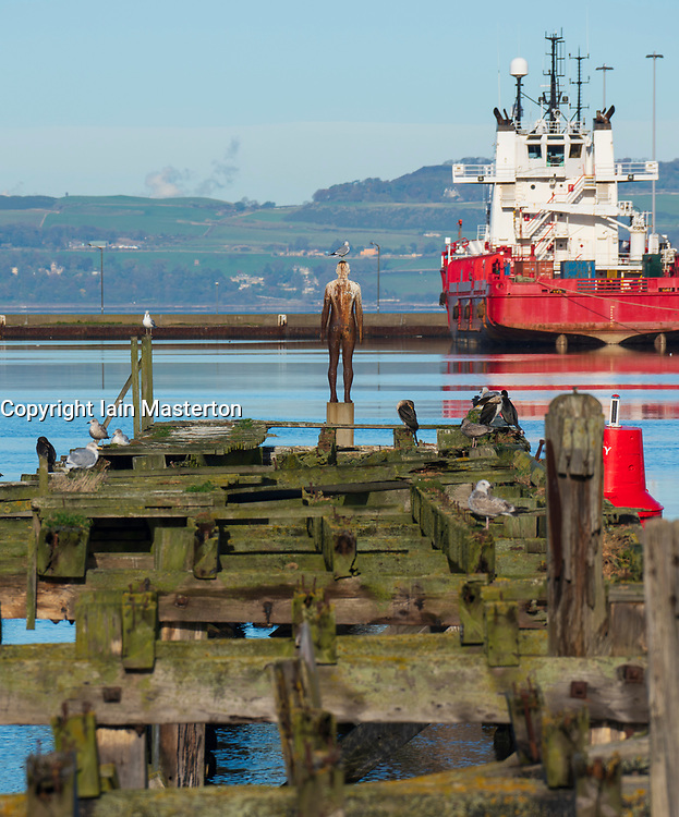 Sculpture by Antony Gormley , Sixth Statue, made from  cast iron,  Port of Leith, Scotland, UK