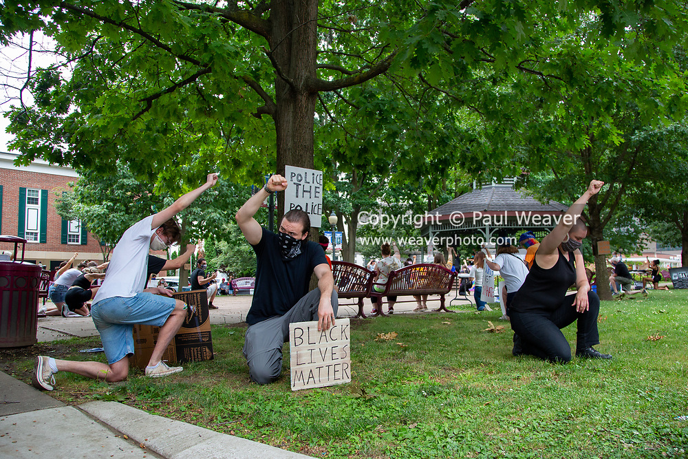 Sunbury, PA (July 12, 2020) -- Demonstrators take a knee for a mont of silence at the Black Lives Matter protest in Sunbury's Cameron Park.