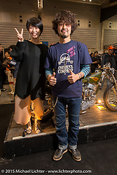 "Kaichiroh ""Kross"" Kurosu in front of his custom Panhead entry and next to a very fashionable friend at the Mooneyes Yokohama Hot Rod & Custom Show. Yokohama, Japan. December 6, 2015.  Photography ©2015 Michael Lichter."