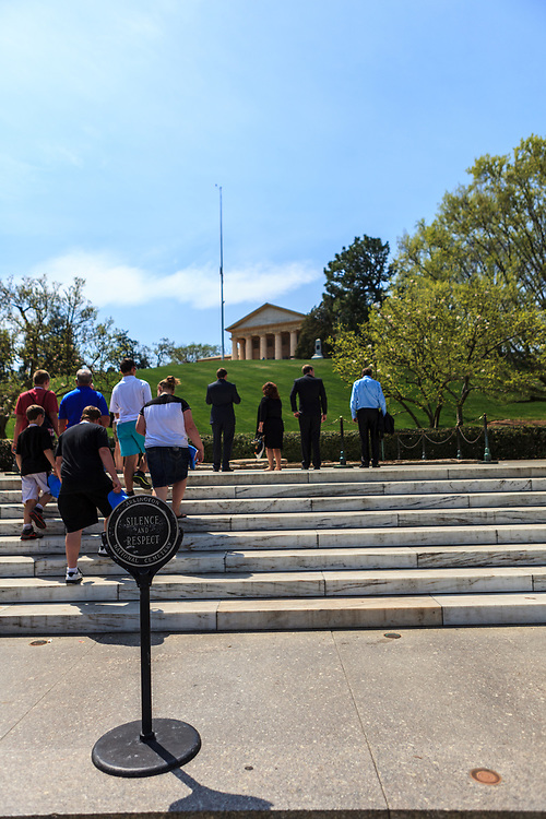 Washington, DC, USA - April 11, 2013: Visitors at President F.  Kennedy's grave in Arlington National Cemetery in Virginia.