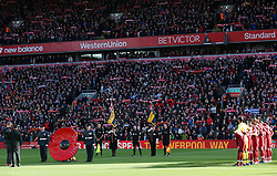 Liverpool players observe a minute's silence to mark the centenary of Armistice Day during the Premier League match at Anfield, Liverpool.