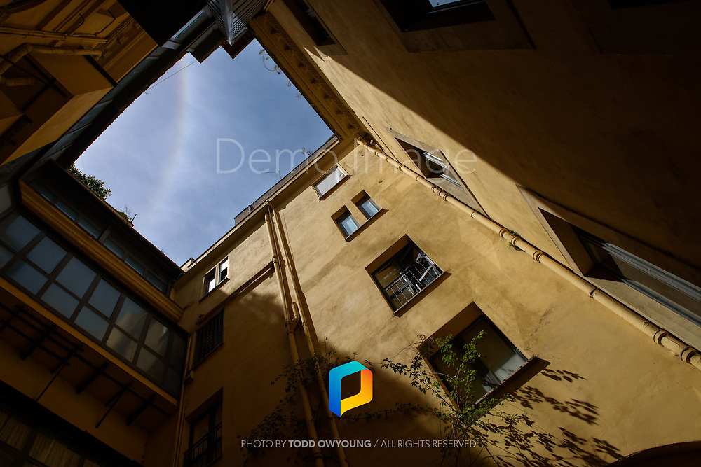 A view looking up in a courtyard in Rome, Italy.