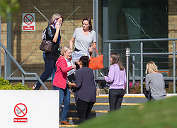 People outside the Peterborough headquarters of tour operator Thomas Cook, which has ceased trading with immediate effect after failing in a final bid to secure a rescue package from creditors.