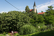 A table and chairs set in a garden below Saint Michael's church, on 23rd June 2018, in Celje, Slovenia.