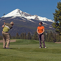 Chad Jones and Lindsey Mitchell play at Big Sky Golf Course in Big Sky, Montana.