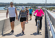 People venture out to walk, bike and exercise along the Rickenbacker Causeway on Saturday, May 2, 2020 as Miami-Dade County opens parks and marinas this week.