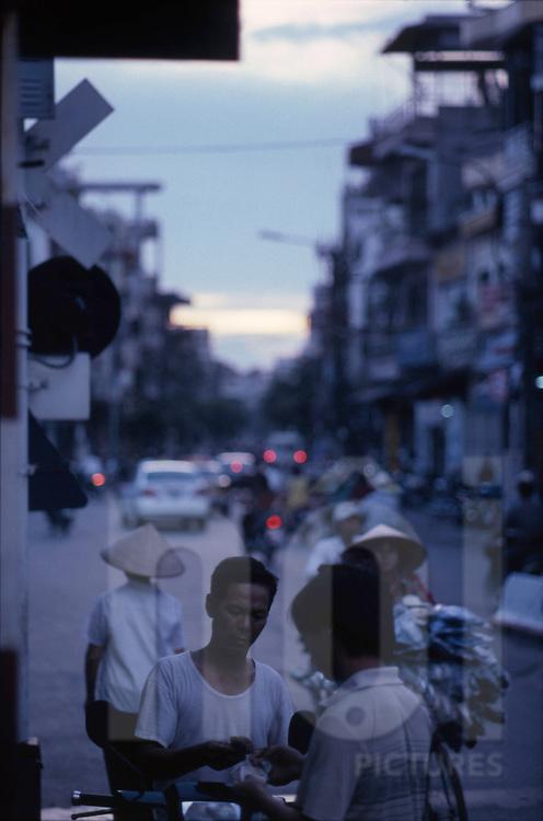 street vendor in Nguyen Khuyen Street, near the Station in Hanoi Vietnam
