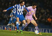 Brighton central midfielder Dale Stephens & Reading striker Yann Kermorgant tussle for possession during the Sky Bet Championship match between Brighton and Hove Albion and Reading at the American Express Community Stadium, Brighton and Hove, England on 15 March 2016. Photo by Bennett Dean.