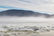 New Windsor, New York - Snow, ice and some fog cover the Hudson River in a view from Plum Point on Jan. 23, 2018.