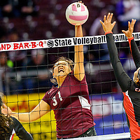 Tohatchi Cougar Latisha Halona (31) spikes on the Eunice Cardinals during the state volleyball tournament at the Santa Ana Star Center in Rio Rancho  Friday.