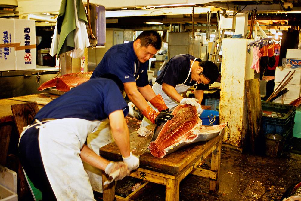 Cutting tuna, Tsukiji Fish Market (Tokyo Central Wholesale Market), Tokyo, Japan