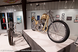Dakota Toomey's Mind Control Zenith Gold 1960's showbike style 1956 Panhead chopper on view in the What's the Skinny Exhibition (2019 iteration of the Motorcycles as Art annual series) at the Sturgis Buffalo Chip during the Sturgis Black Hills Motorcycle Rally. SD, USA. Friday, August 9, 2019. Photography ©2019 Michael Lichter.