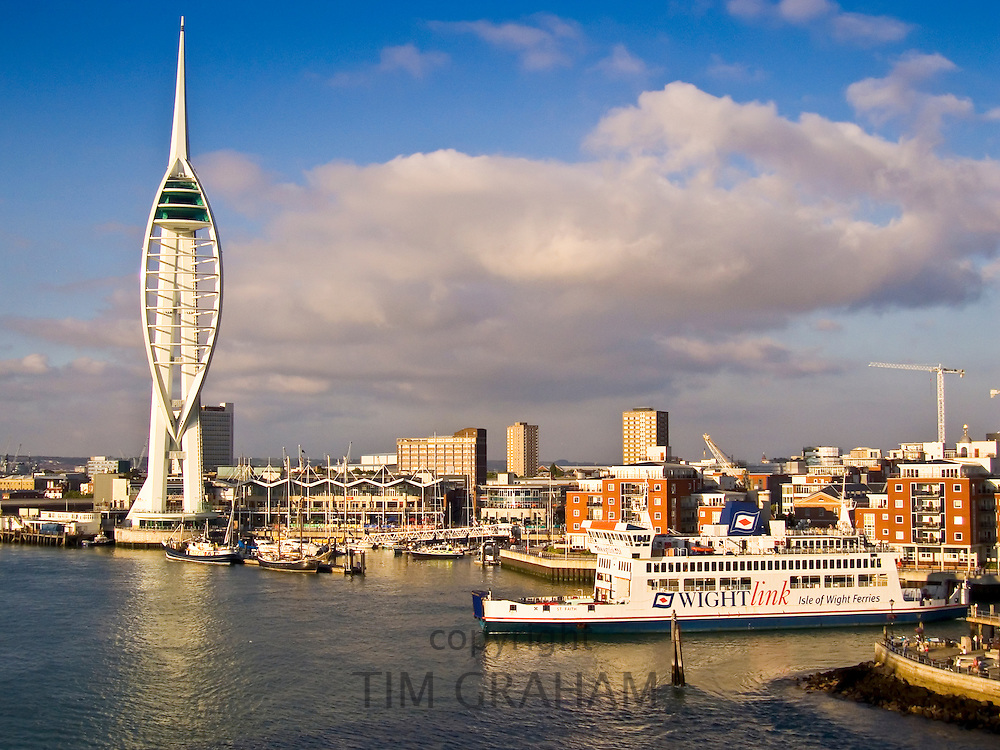 Isle of Wight Ferry boat passes Spinnaker Tower in Portsmouth Harbour, England