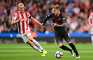 Aaron Ramsey of Arsenal ® in action with Darren Fletcher of Stoke city. Premier league match, Stoke City v Arsenal at the Bet365 Stadium in Stoke on Trent, Staffs on Saturday 19th August 2017.<br /> pic by Bradley Collyer, Andrew Orchard sports photography.