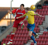 Photo: Kevin Poolman.<br />Swindon Town v Hereford United. Coca Cola League 2. 04/11/2006. Lee Peacock of Swindon and Dean Beckwith of Hereford both go up for a header.