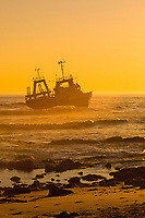 A shipwreck on  the Skeleton Coast at sunset (the Kilmanskop), Swakopmund, (the Atlantic Ocean off of the Namib Desert coastline), Namibia