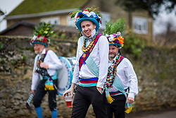 © Licensed to London News Pictures. 13/01/2018. Whittlesey UK. A member's of Earlsdon Morris this morning at the 39th Whittlesey Straw Bear Festival taking place today. In times past when starvation bit deep the ploughmen of the area where drawn to towns like Whittlesey, They knocked on doors begging for food & disguised their shame by blackening their faces with soot. In Whittlesey it was the custom on the Tuesday following Plough Monday to dress one of the confraternity of the plough in straw and call him a Straw Bear. The bear was then taken around town to entertain the folk who on the previous day had subscribed to the rustics, a spread of beer, tobacco & beef. The bear was made to dance in front of houses & gifts of money, beer & food was expected.Photo credit: Andrew McCaren/LNP