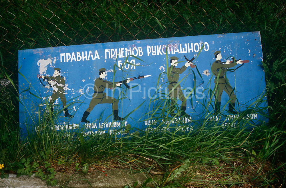 Old Soviet parade ground illustrations show self-defence positions for Russian soldiers in the former Russian army camp in occupied East Germany ex-GDR/DDR, on 16th June 19990, on Halb Insel Wustrow, near Rostock, Germany. Wustrow was once a WW2 German anti-aircraft artillery position then housing civilian refugees before the eventual Soviet occupation of the former DDR during the Cold War, up until 1990 and the fall of communism and the Berlin Wall. The camp was ransacked and all its assets stripped before its desertion that summer and is a reminder of a fallen ideology.