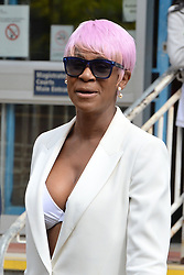 Susan Okoya, 44, arrives at Camberwell Green Magistrates' Court in London, where she is accused of breaching a restraining order by contacting former Manchester United and England footballer Rio Ferdinand.