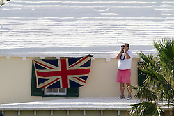 A British supporter watches from a rooftop during the quarter finals of the Argo Group Gold Cup 2010. Hamilton, Bermuda. 9 October 2010. Photo: Subzero Images/WMRT