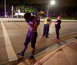 August 18, 2018 - Wellington, Florida, U.S. - Palm Beach Central football player Derrick Cruickshank stands at the corner of Forest Hill Boulevard and Lyons Road after a shooting sent players and fans scattering in all directions. Two adults were shot Friday night at a football game between Palm Beach Central and William T. Dwyer high schools, authorities said. The gunfire sent players and fans screaming and stampeding in panic during the fourth quarter of the game at Palm Beach Central High School in Wellington, Florida on August 17, 2018. (Credit Image: © Allen Eyestone/The Palm Beach Post via ZUMA Wire)