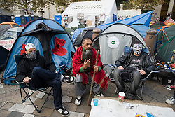 © Licensed to London News Pictures. 16/11/2011. London, UK. Members of the the Occupy London camp outside St Paul's CAthedral Today (16/11/2011). The City of London Corporation has relaunched legal action against the anti-capitalist protesters after peace talks broke down. Photo credit: Ben Cawthra/LNP