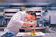 Executive Chef Paula DaSilva prepares presentation of olive oil poached swordfish at the now-closed restaurant 1500 Degrees in Miami Beach's Eden Roc hotel