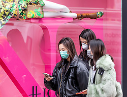 © Licensed to London News Pictures. 13/03/2020. London, UK. Shoppers in masks in Knightsbridge. Knightsbridge appears very quiet this morning as Prime Minister Boris Johnson warned that anyone with cold like symptoms should self-isolate as the World Health Organization declares that the Coronavirus disease is a Pandemic. Photo credit: Alex Lentati/LNP