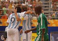 Football-FIFA Beach Soccer World Cup 2006 - Group D-ARG_NGA - Opening match of the Beachsoccer World Cup 2006. Ezequiel Lopez-ARG celebrates his goal with Facundo Minici- Rio de Janeiro - Brazil 02/11/2006<br />Mandatory credit: FIFA/ Marco Antonio Rezende.