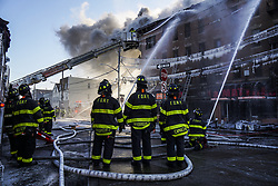 January 2, 2018 - Bronx, New York, U.S. - NDNY firefighters battle 7 alarm fire on Tuesday in the Bronx.  The Fire broke just before 6 am injuring at least 23 people. (Credit Image: © Go Nakamura via ZUMA Wire)