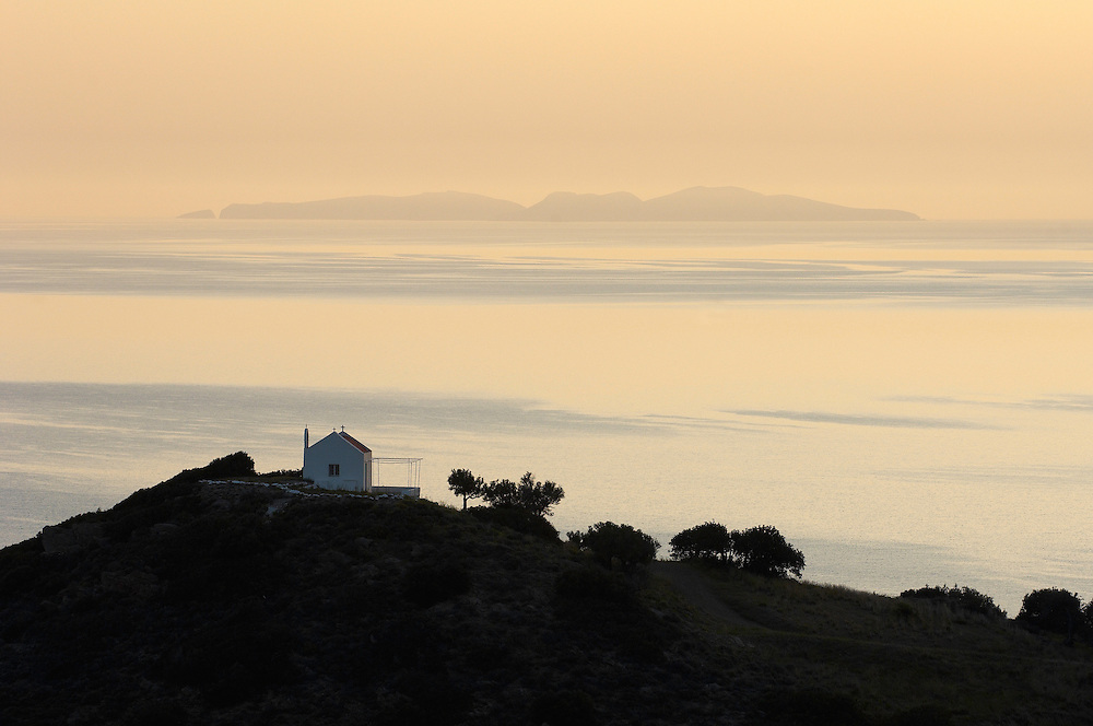 Morning light over the sea and a church near Mochlos, Crete