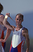Barcelona, SPAIN. Gold Medalist, GBR M2+, Gary HERBERT.  lift's his Gold medal, on the awards dock. 1992 Olympic Rowing Regatta Lake Banyoles, Catalonia [Mandatory Credit Peter Spurrier/ Intersport Images] Last time Men's coxed pair raced at the Olympics