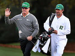 Charley Hoffman, left, acknowledges the applause of the gallery as he and his caddie, Brett Waldman, right, arrive at the 18th green during first-round action of the Masters Tournament at Augusta National Golf Club on Thursday, April 6, 2017, in Augusta, Ga. Hoffman finished the round at -7. (Photo by Jeff Siner/Charlotte Observer/TNS) *** Please Use Credit from Credit Field ***