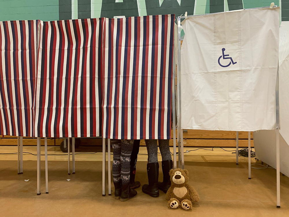 A teddy bear awaits its owners who are helping their parent vote in New Hampshire.